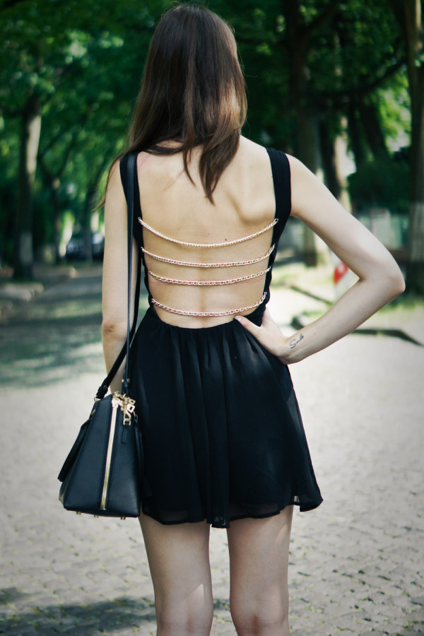 black dress with gold details