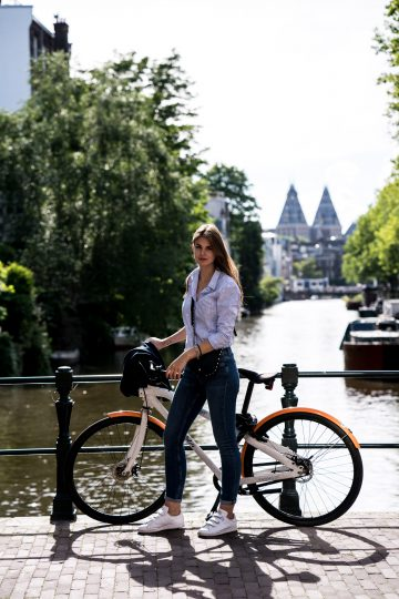 Cycling through Amsterdam in my GANT Outfit