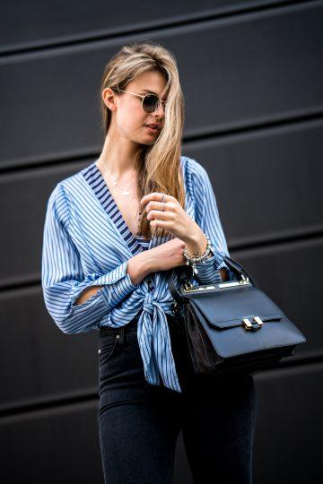 Wie trägt man eine schwarze Tasche