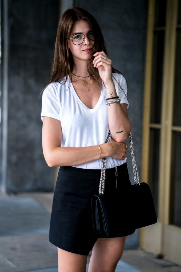 Wearing a black Skirt with Zipper Details