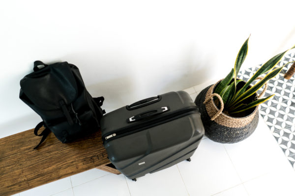 travelling with a suitcase and backpack