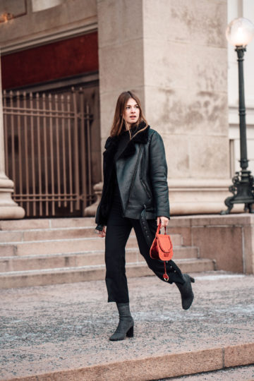 Oslo Runway Outfit: Red Bag combined with an all black Look