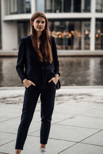 Casual Chic Outfit: Women's suit combined with sneakers