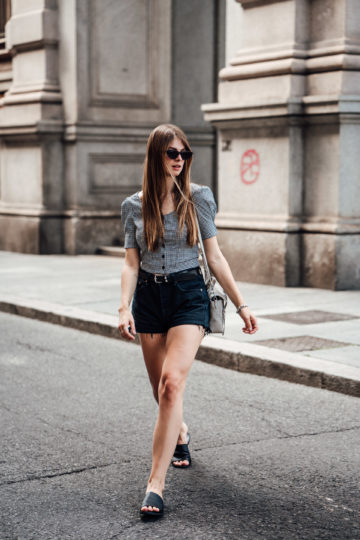 Travel Outfit: Gingham Blouse combined with black Denim Shorts