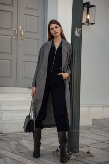 combining a jumpsuit and heeled boots