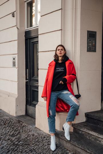 Wearing a red coat in winter