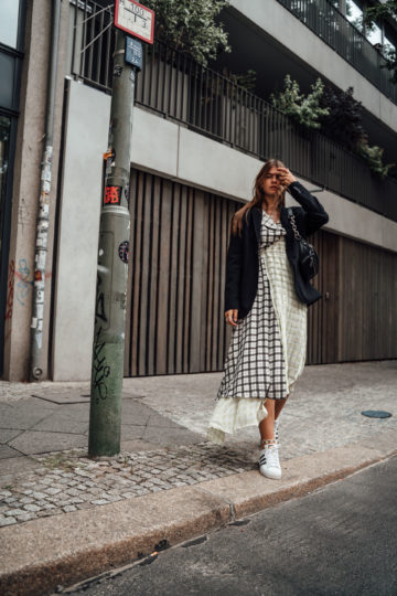 combining a midi dress with Sneakers